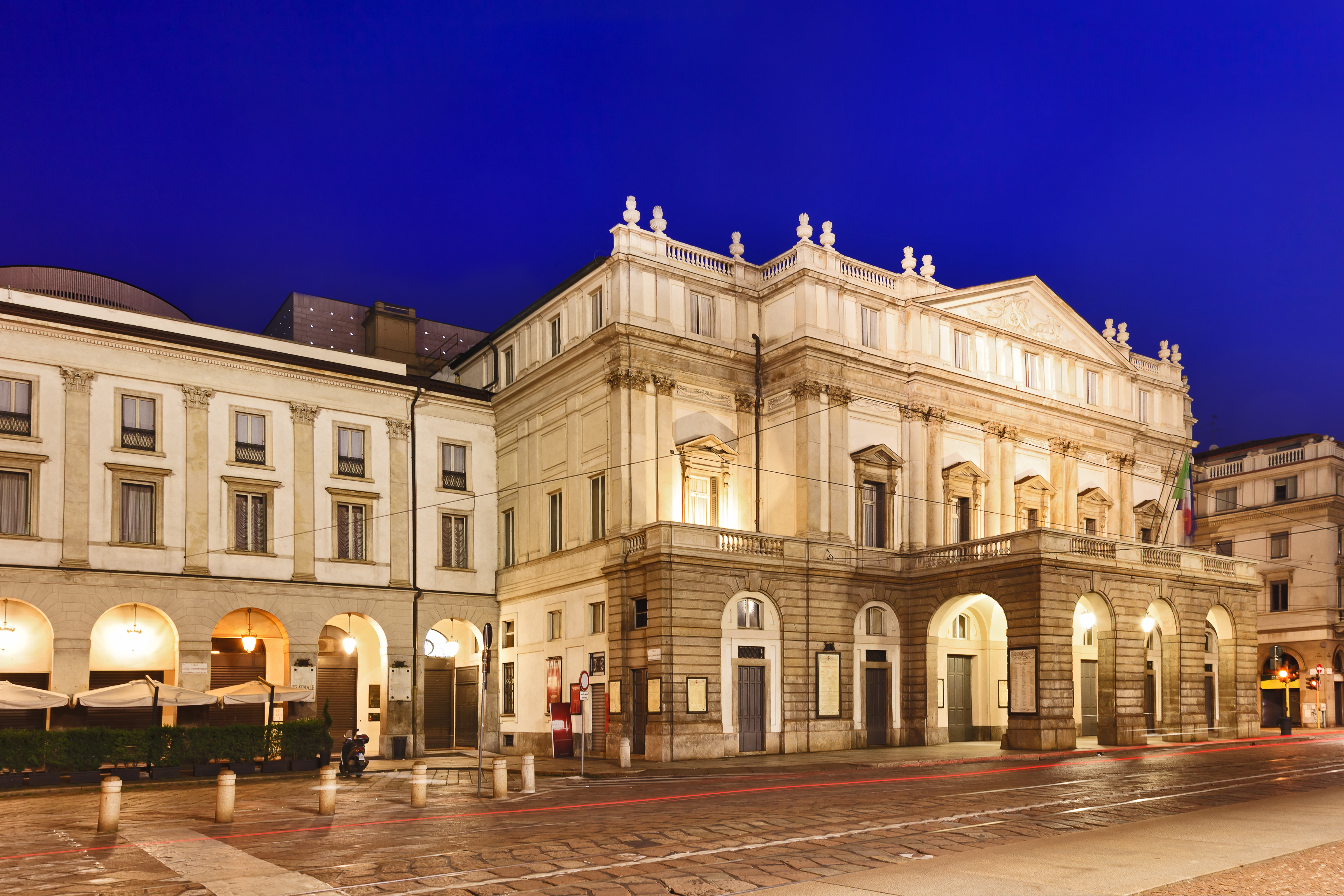 Italy lombardy milan city landmark la scala theater building illuminated with lights at sunrise facade neo classical style nobody